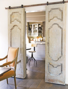 sliding door made by upcycling an old door & Creative Ways to Upcycle Old Doors | ID Blog